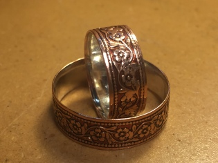 Copper wide daisy chain band with a fine silver lining